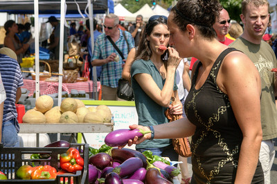 A woman browses through egg plants at the Dupont Circle FRESHFARM Market, a farmers' market with produce and baked goods from local farms, located at 20th Street NW in Dupont Circle in Washington, DC,  on Sunday, August 17, 2014. Copyright 2014 Jason Barnette