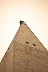 "Dave Megerle, a member of engineering firm Wiss, Janney, Elstner, Associates ""Difficult Access Team,"" attaches ropes to the top of the Washington Monument, on the National Mall, in Washington, Tuesday, Sept. 27, 2011, from which four people will rappel down the sides to survey the extent of damage sustained to the monument from the August 23 earthquake which shook much of the East Coast. According to the Park Service, the heaviest damage appears to be concentrated at the very top of the monument, in what is called the pyramidion, where large cracks of up to 1-1/4 inch wide developed through stone and mortar joints. The Washington Monument, built between 1848 and 1884, is 555 feet, 5-1/8 inches tall. Its walls, 15-feet thick at the base and 18-inches at the top, are composed primarily of white marble blocks. (Photo by Jeff Malet)"