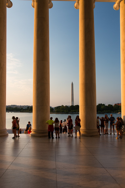 Tourist enjoying the view of the Tidal Basin and the Washington Monument from the Jefferson Memorial. Washington, DC<br /> <br /> DC-120628-0151