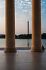 A teenager sits by the columns of the Jefferson Memorial enjoying the last few minutes of sunlight. Washington, DC<br /> <br /> DC-120628-0182