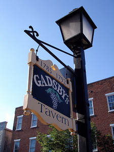 Outside Gadsby's Tavern.  Gadsby's Tavern in Alexandria is a landmark. Its two buildings were constructed around 1785 and 1792. George Washington celebrated his birthday there. Other visitors were Thomas Jefferson, John Adams, James Madison, and James Monroe. - Alexandria, VA ... May 28, 2005 ... Photo by Rob Page III