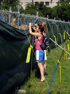 Hotlanta attempting to take photos of the White House through the construction fence - Washington D.C. ... May 27, 2005 ... Photo by Rob Page III