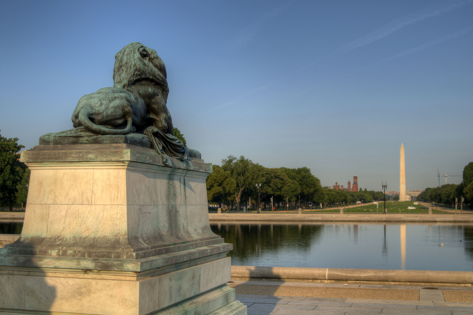 One of the lions of the Ulysses S. Grant Memorial looking out across the National Mall toward the Washington Monument in Washington, DC, on Saturday, August 16, 2014. Copyright 2014 Jason Barnette
