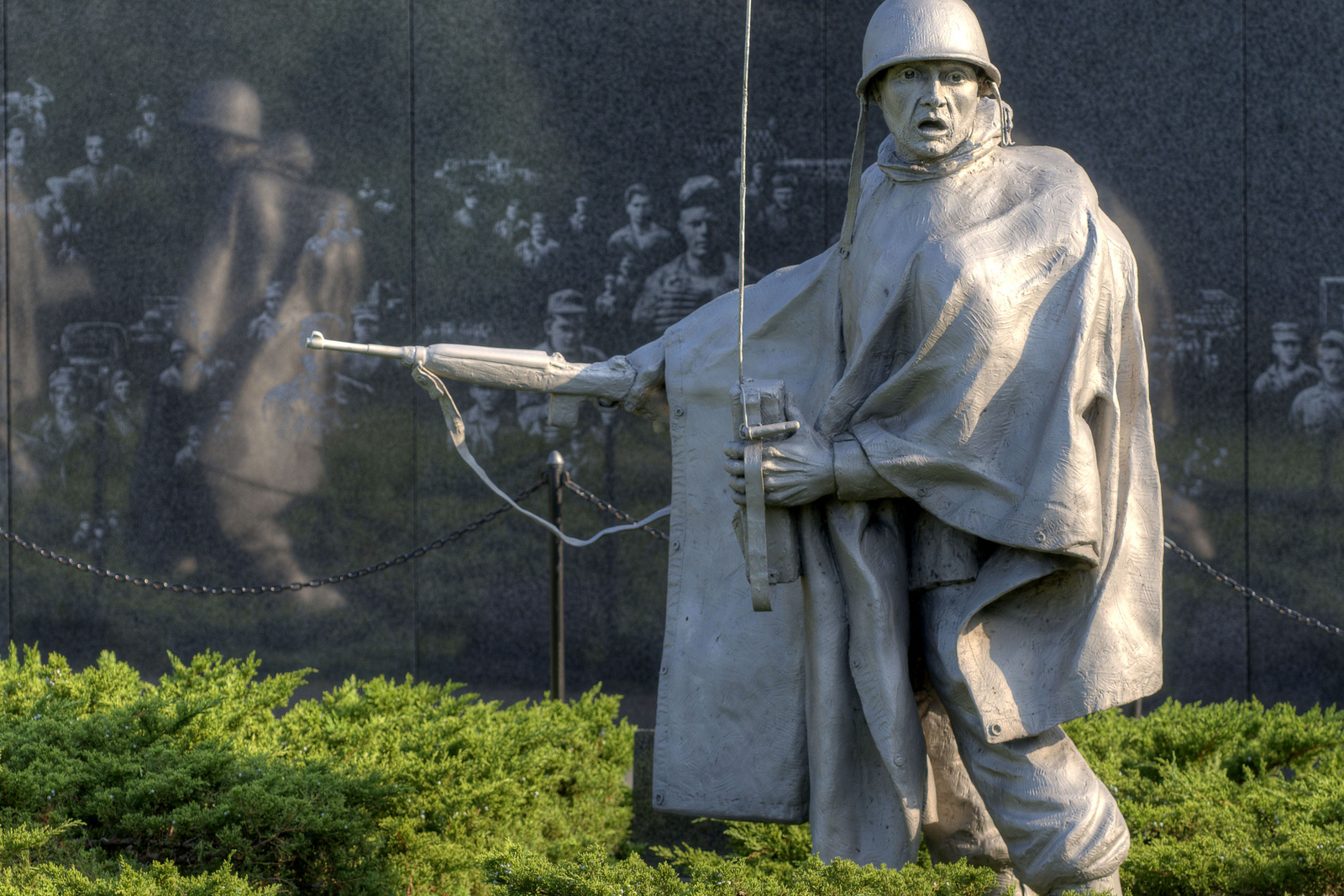 A statue is reflected in the wall of the Korean War Veterans Memorial in Washington, DC, on Sunday, August 17, 2014. Copyright 2014 Jason Barnette