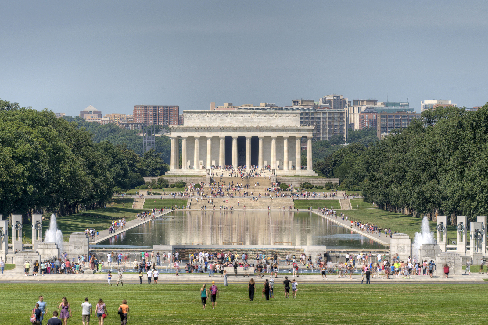 Hundreds of people walk the lawn and explore the National WWII Memorial and Lincoln Memorial in Washington, DC, on Saturday, August 16, 2014. Copyright 2014 Jason Barnette