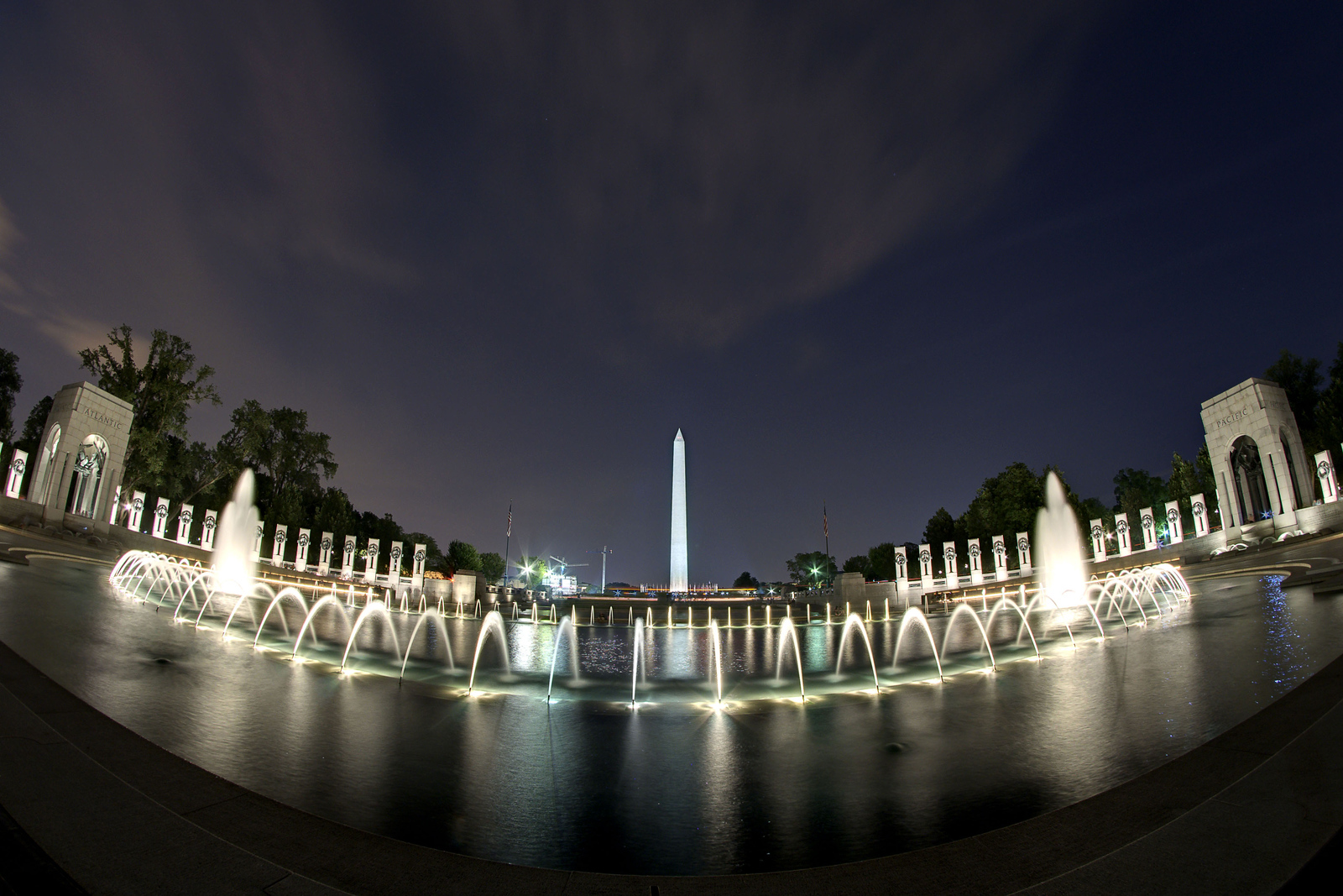 The Washington Monuments stands tall in the distance beyond the National WWII Memorial in Washington, DC, on Friday, August 15, 2014. Copyright 2014 Jason Barnette