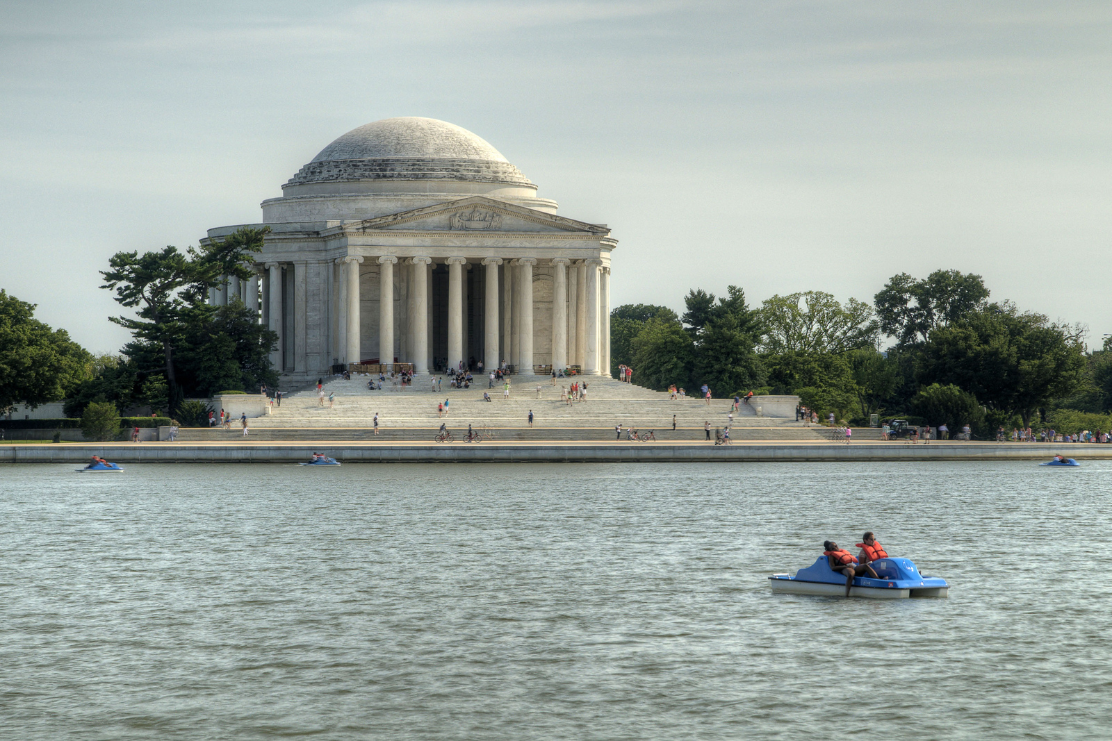 People explore the Tidal Basin in pedal powered boats near the Jefferson Memorial in Washington, DC, on Saturday, August 16, 2014. Copyright 2014 Jason Barnette