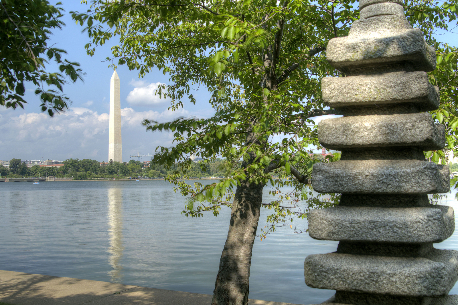 The Washington Monument is seen beyond the Japanese Stone Pagoda on a trail around the Tidal Basin in Washington, DC, on Sunday, August 17, 2014. Copyright 2014 Jason Barnette