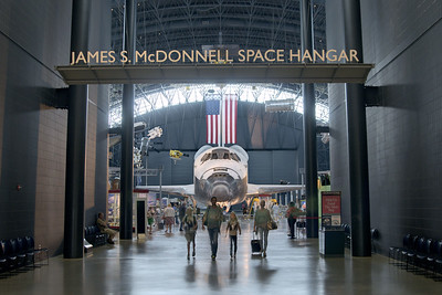 A family leaves the James S. McDonnell Space Hangar, now home to the space shuttle Discovery, at the National Air and Space Museum Stephen F. Udvar-Hazy Center at Dulles International Airport in Chantilly, VA on Monday, August 18, 2014. Copyright 2014 Jason Barnette