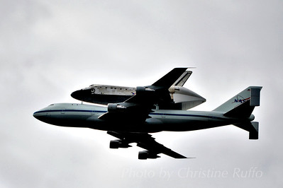Space Shuttle Discovery flies over Washington, D.C. on its way to the National Air and Space Udvar-Hazy Center.