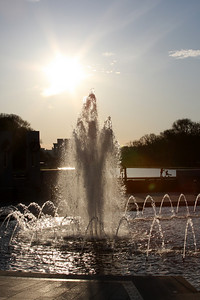 The setting sun over the World War II Memorial - Washington, DC ... April 2, 2008 ... Photo by Rob Page III