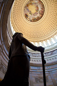 "The US Capitol Rotunda is a large, domed, circular room located in the center of the Capitol on the second floor. Here a statue of George Washington looks up at the  Rotunda canopy, a 4664-square-foot fresco painting entitled ""The Apotheosis of Washington"" depicting the first President of the United States rising into the clouds in glory.  Washington DC - Sept. 21, 2010"