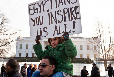 """Demonstrators  demanding that Egyptian President Hosni Mubarak vacate his office gathered outside the White House in Washington DC on Sunday, January 30, 2011. Mubarak has been head of government in Egypt for 30 years. In recent days, thousands of Egyptians have poured into the streets of several cities to call for a change in government. Sign reads """"Egyptians You Inspire Us All"""". (Photo by Jeff Malet)"""