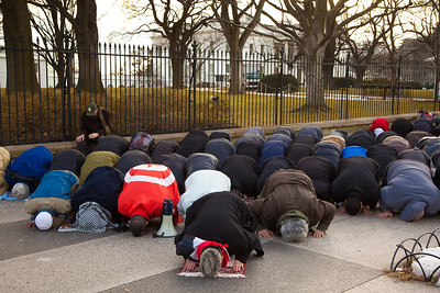 Demonstrators demanding that Egyptian President Hosni Mubarak vacate his office pause for Friday afternoon prayers in front of the White House prior to a planned march to Capitol Hill in Washington DC on Friday, February 4, 2011. Mubarak has been head of government in Egypt for 30 years. In recent days, thousands of Egyptians have poured into the streets of several cities to call for a change in government. Daily prayer is one of the five pillars of Islam and Friday's afternoon prayer has special significance because it is the week's lone communal prayer. (Photo by Jeff Malet)