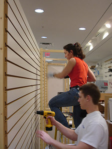 Rosie and JT taking down the Skandia during the Container Store's transition - Washington, DC ... February 7, 2006 ... Photo by Rob Page III
