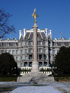 The First Division Monument is located in President's Park, west of the White House and south of the Dwight D. Eisenhower Executive Office Building.  The monument was conceived by the Society of the First Division to commemorate the lives of members of the division who died during World War I. The stately column surmounted by an allegorical statue of Victory was dedicated on October 4, 1924 - Washington, DC ... December 9, 2005 ... Photo by Rob Page III