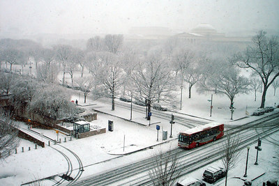 A snowy day on the National Mall with the Circulator bus passing by - Washington, DC ... February 24, 2007 ... Photo by Rob Page III