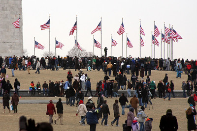 The crowds mass on around the Washington Monument - Washington, DC ... January 18, 2009 ... Photo by Rob Page III