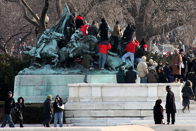 People climbed to wherever they could see.  This was hours before Obama's swearing in - Washington, DC ... January 20, 2009 ... Photo by Rob Page III