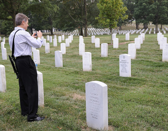Dennis revisits his father's burial spot.