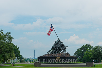 Iwo Jima Memorial with monuments in background.