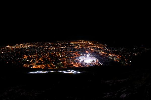 "The ""M"" over Missoula  The ""M"" illuminated overlooking Missoula and The Washington Grizzly Stadium during the Montana Grizzly vs Northern Iowa. Montana Grizzlies win 48-10 and advance to the next round in the playoffs. December 9th, 2011. Missoula, Montana  Please note the watermark in the image will not be in the image when printed. Panoramic sizes work best with this image, eliminating the large dark areas from the top and bottom and giving you a wide narrow print."