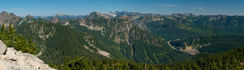 This is similar to the panorama I took from Mt. Catherine (you know, because it's in the same area). Far away, on the left is Glacier Peak; most of the other peaks are labeled in the other picture. That stretch of road is Snoqualmie Pass on I-90.