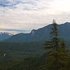 "Facing the other way, there's a decent view of Skykomish Valley. Inhabitants of the valley seem to call it ""Sky Valley"", which seems kind of oxymoronic. I think that's Heybrook Mountain and Heybrook Ridge near the road, and Some Peak obscuring Gunn Peak on the right. I couldn't get rid of the tree, unfortunately ..."