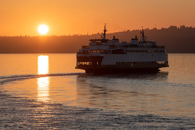 Washing State Ferry back lit by the rising sun