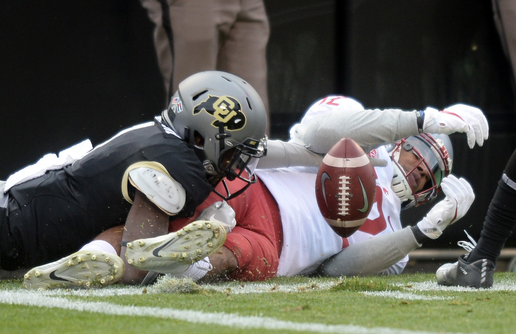 . BOULDER, CO: November 10:  Delrick Abrams, Jr. of CU, breaks up a pass to Dezmon Patmon, of WSU,during the game with Washington State. (Photo by Cliff Grassmick/Staff Photographer)