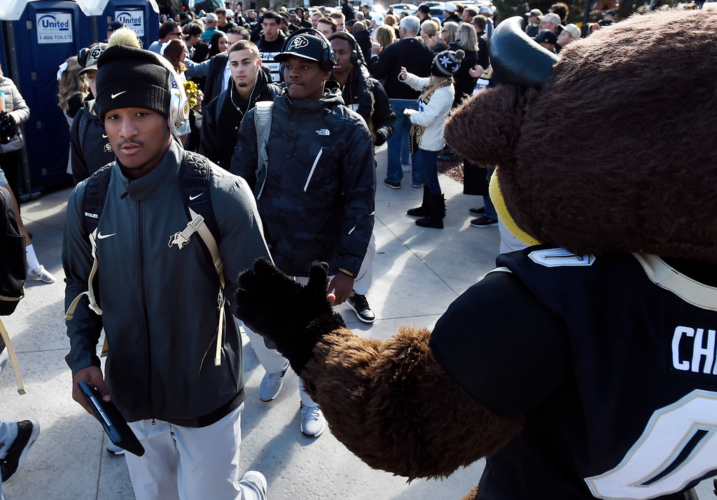 . BOULDER, CO: November 10: Travon McMillian arrives with the team before the game with Washington State. (Photo by Cliff Grassmick/Staff Photographer)