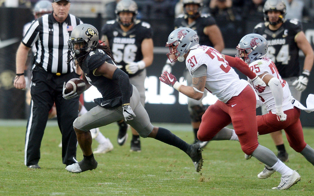. BOULDER, CO: November 10:  Laviska Shenault, of CU, runs past Justus Rogers, of WSU, during the game with Washington State. (Photo by Cliff Grassmick/Staff Photographer)