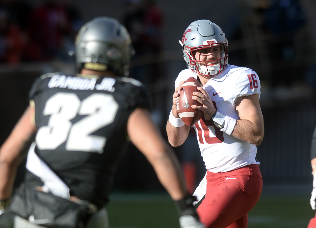 . BOULDER, CO: November 10: Gardner Minshew II, of WSU, looks to pass on Rick Gamboa, of CU, during the game with Washington State. (Photo by Cliff Grassmick/Staff Photographer)