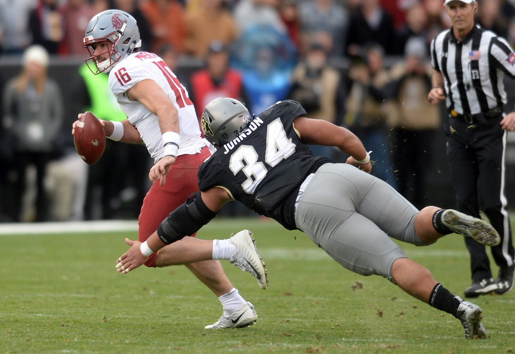 . BOULDER, CO: November 10:  Gardner Minshew II, of WSU, escapes Mustafa Johnson, of CU, during the game with Washington State. (Photo by Cliff Grassmick/Staff Photographer)