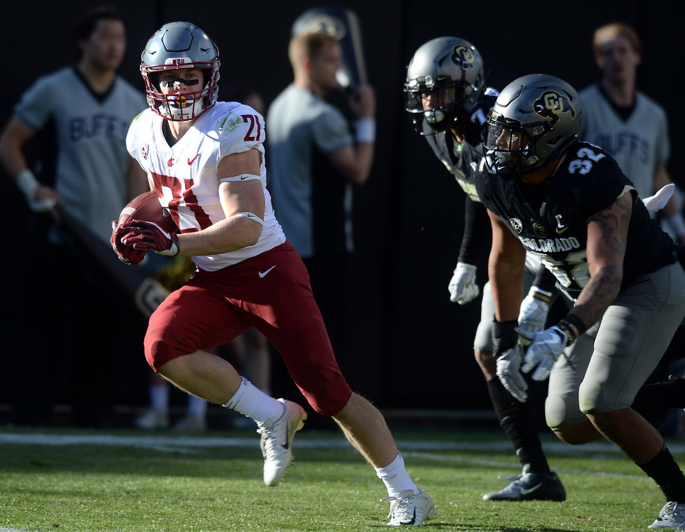 . BOULDER, CO: November 10: Max Borghi, of WSU, scores a touchdown during the game with Washington State. (Photo by Cliff Grassmick/Staff Photographer)