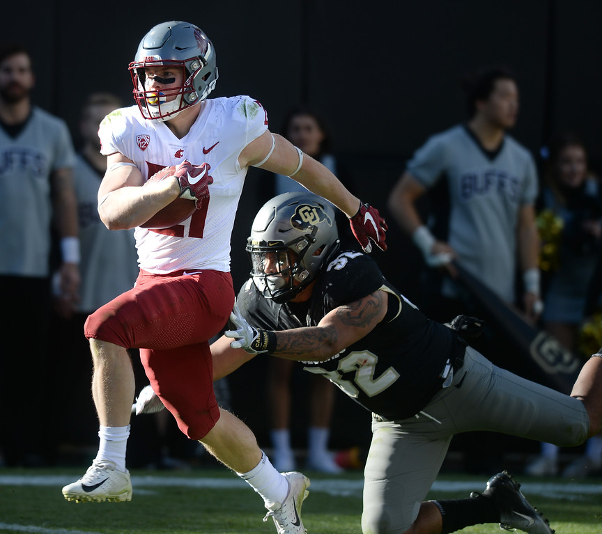 . BOULDER, CO: November 10: Max Borghi, of WSU, gets past Rick Gamboa to score a touchdown during the game with Washington State. (Photo by Cliff Grassmick/Staff Photographer)