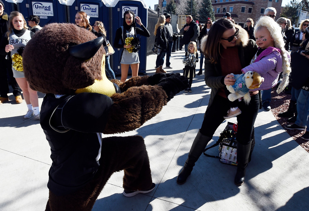 . BOULDER, CO: November 10: Scarlett Shimer, 2, and her mother, Ally, decide they don\'t want to meet Chip after all  before the game with Washington State. (Photo by Cliff Grassmick/Staff Photographer)