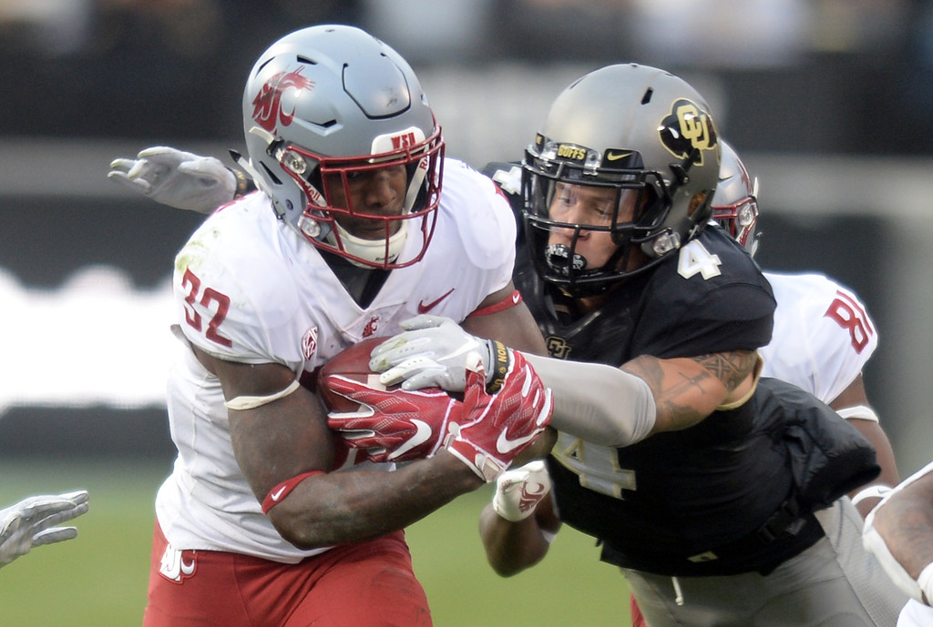 . BOULDER, CO: November 10: Dante Wigley, of CU, tackles James Williams, of WSU, during the game with Washington State. (Photo by Cliff Grassmick/Staff Photographer)