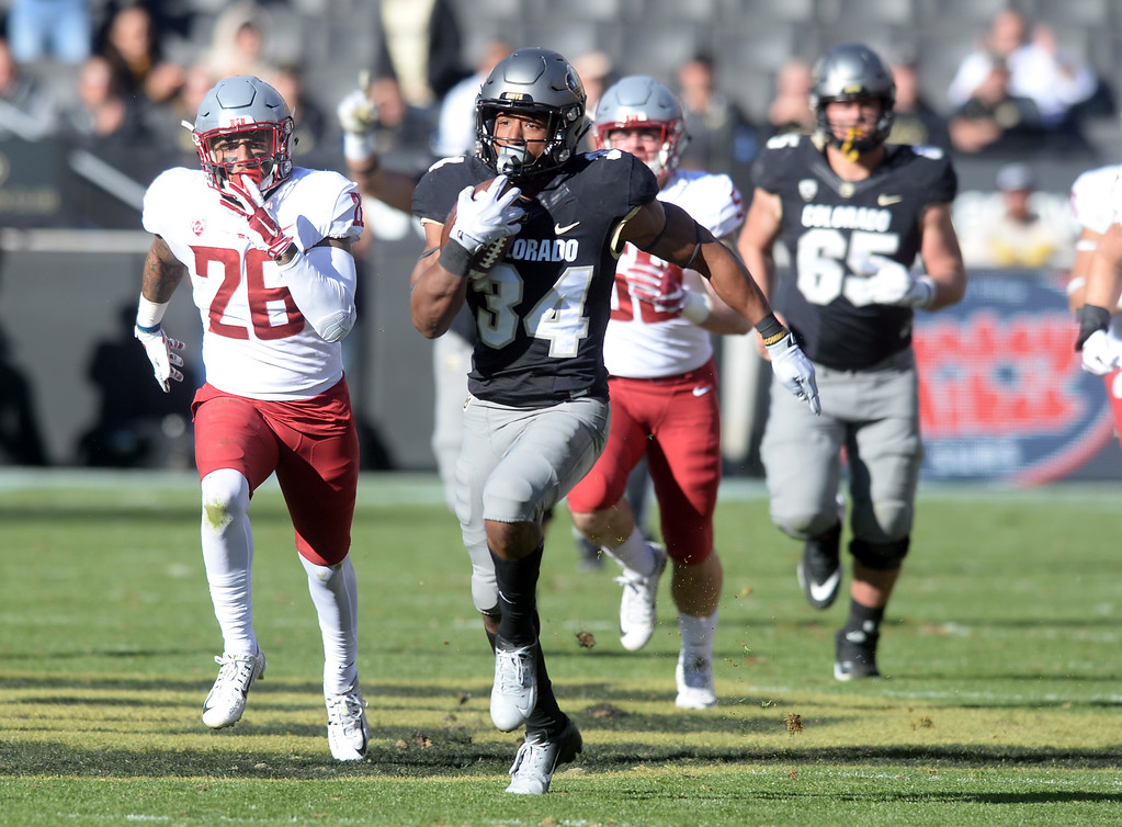 . BOULDER, CO: November 10: Travon McMillian, of CU, breaks a long long run during the game with Washington State. (Photo by Cliff Grassmick/Staff Photographer)