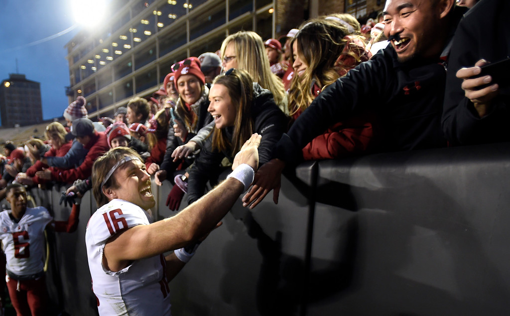 . BOULDER, CO: November 10: WSU QB, Gardner Minshew II celebrates with fans after the win over CU. (Photo by Cliff Grassmick/Staff Photographer)