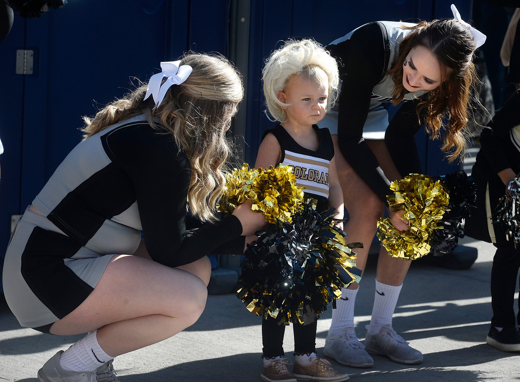 . BOULDER, CO: November 10: Scarlett Shimer, 2, is a little shy with the CU Spirit Squad before the game with Washington State. (Photo by Cliff Grassmick/Staff Photographer)