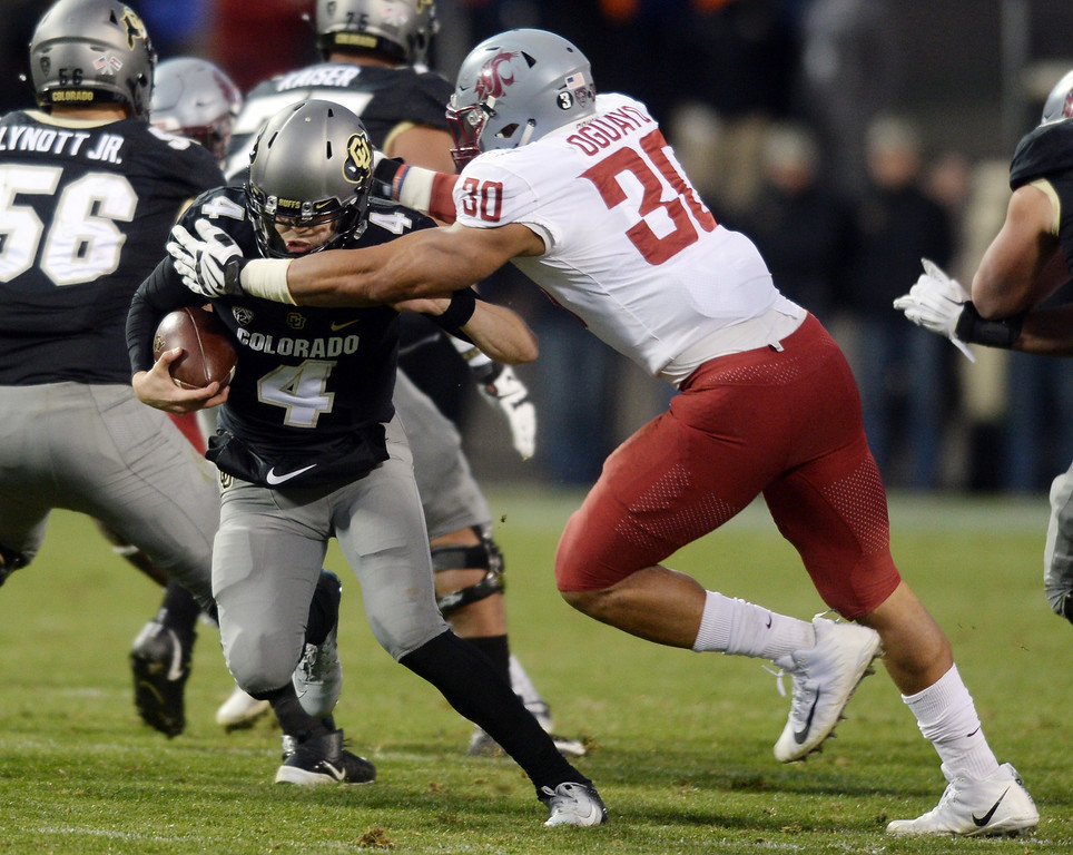 . BOULDER, CO: November 10:  Sam Noyer, gets pulled Nnamdi Oguayo, of WSU, during the game with Washington State. (Photo by Cliff Grassmick/Staff Photographer)