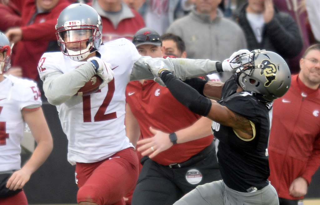 . BOULDER, CO: November 10: Dezmon Patmon, of WSU, straight arms Nick Fisher, of CU, during the game with Washington State. (Photo by Cliff Grassmick/Staff Photographer)