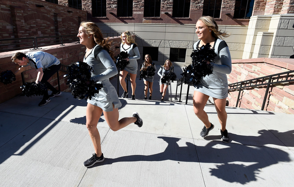 . BOULDER, CO: November 10:The CU Dance Team members race over to the Buff Walk before the game with Washington State. (Photo by Cliff Grassmick/Staff Photographer)