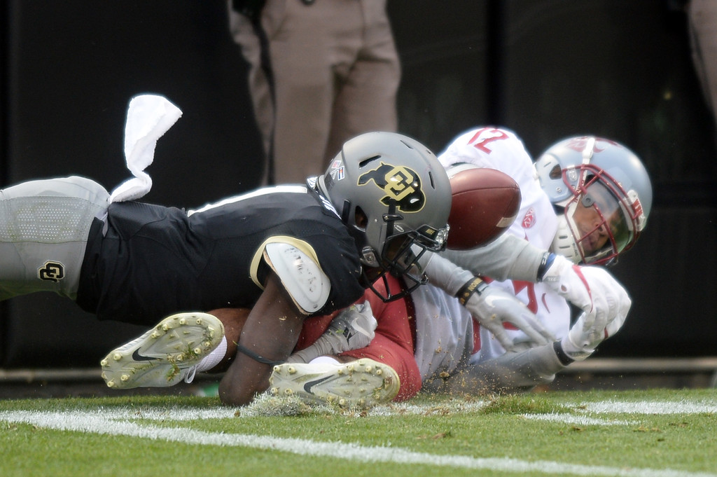 . BOULDER, CO: November 10: Delrick Abrams, Jr. of CU, breaks up a pass to Dezmon Patmon, of WSU, during the game with Washington State. (Photo by Cliff Grassmick/Staff Photographer)