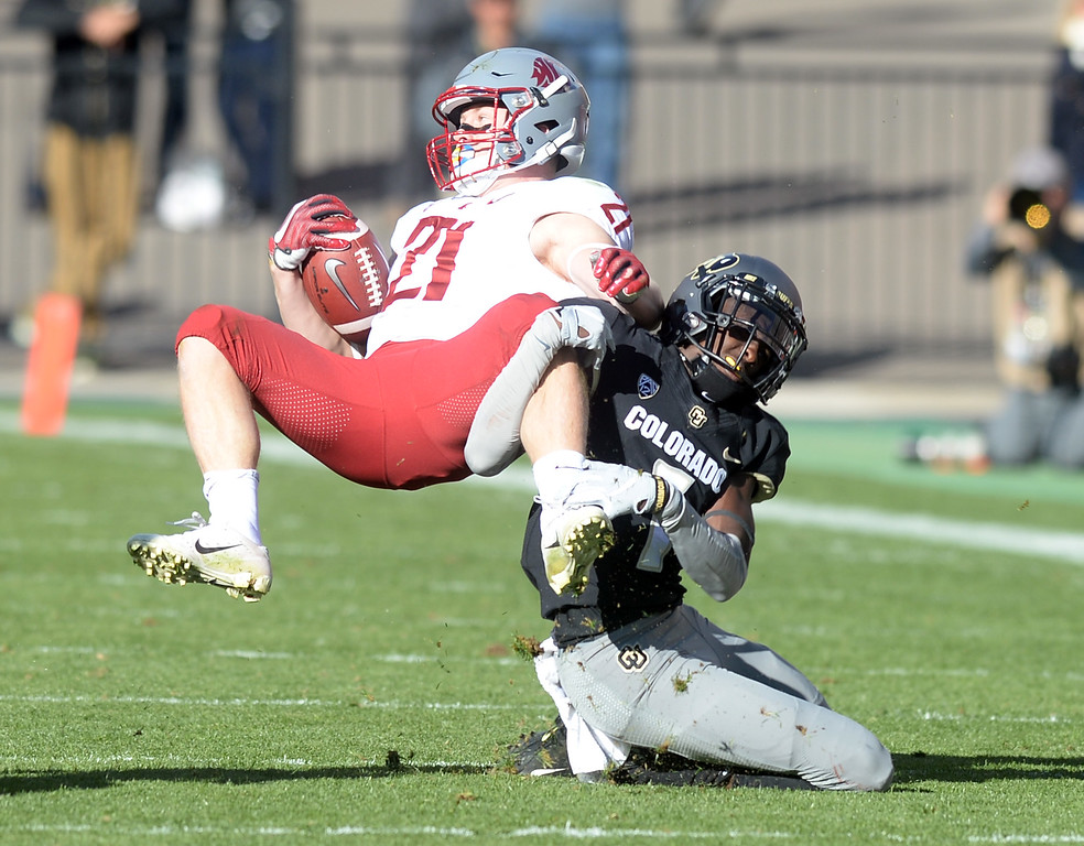 . BOULDER, CO: November 10: Delrick Abrams, Jr. of CU, undercuts  Max Borghi, of WSU, during the game with Washington State. (Photo by Cliff Grassmick/Staff Photographer)