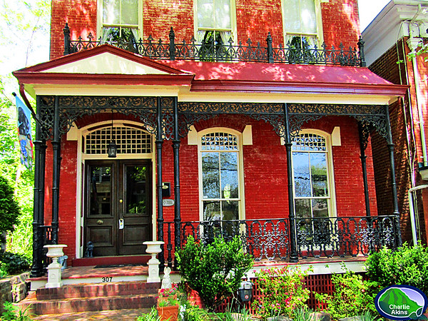 I love the iron work on the porch.