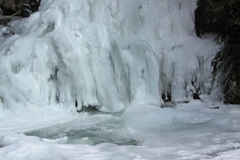 At the lower falls the water has become sheathed in ice.