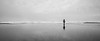 Grays Harbor, Seabrook - Woman walking along beach with reflection, black and white