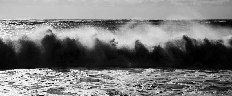 Grays Harbor, Damon Point - Waves crashing ashore backlit by sun, black and white